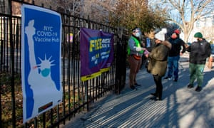 People arrive to receive a dose of the Moderna coronavirus vaccine at a vaccination site at South Bronx Educational Campus, in the Bronx New York on 10 January 2020.