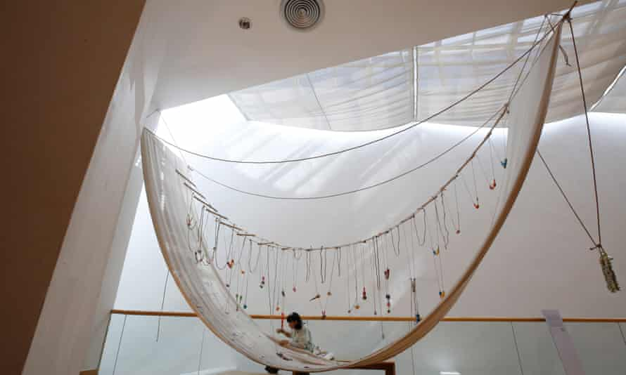 A Stitch in Time by David Medalla, in which visitors were asked to sew cotton stitches (or anything else it liked) on to a skein of fabric hanging from a gallery ceiling, as seen at an exhibition in Bangkok, Thailand, in 2019.
