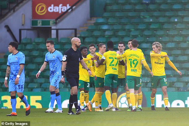 The Norwich players celebrate after Kenny McLean put the hosts ahead against Coventry