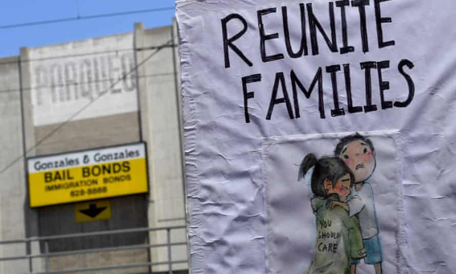 Signs during a march and rally against the separation of immigrant families on 30 June 2018 outside the detention facility of the Immigration and Customs Enforcement (Ice) in Los Angeles, California.