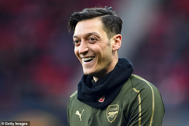 Mesut Ozil would leave Arsenal if the club pay his wages for two more years, say reports