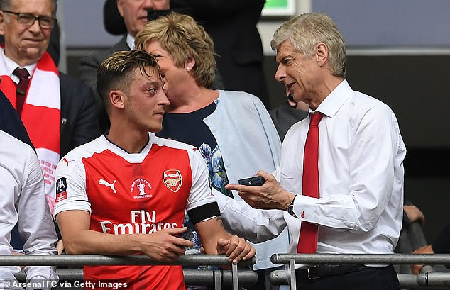 Ozil was in the side who won the FA Cup against Chelsea under Arsene Wenger (right) in 2017