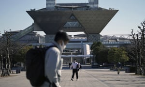 People walk past the Tokyo International Exhibition Centre in Tokyo, Japan.