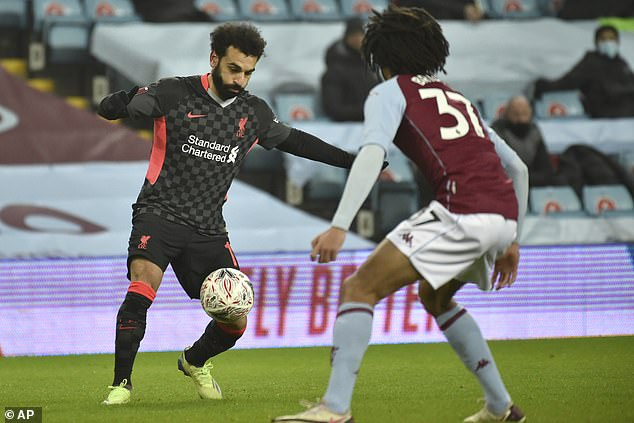 Liverpool, meanwhile, fielded Mohamed Salah (left) and other stars such as Sadio Mane