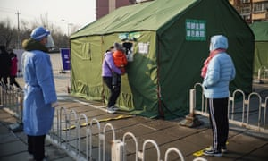 Residents wait in line for nucleic acid test at a COVID-19 testing site in Daxing District of Beijing, China, January 20, 2021.
