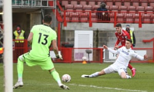 Crawley Town's Ashley Nadesan scores his side's second goal.