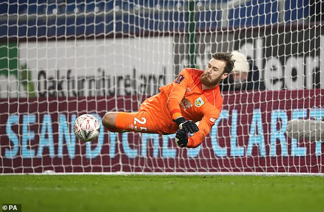 Burnley stopper Will Norris made a crucial save against Lasse Sorensen in the shootout