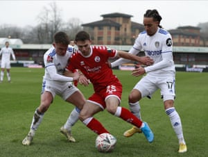 Crawley Town's Nicholas Tsaroulla, centre, duels for the ball with Leeds United's Helder Costa, right, and Jamie Shackleton.