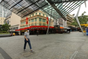 A person wears a mask in Brisbane's Queens St Mall on Sunday.