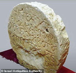 Ancient Greek writing is show engraved on the front side of the tombstone