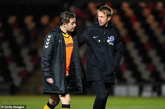 The Brighton boss talks with Newport's Matt Dolan (left) after the FA Cup tie at Rodney Parade