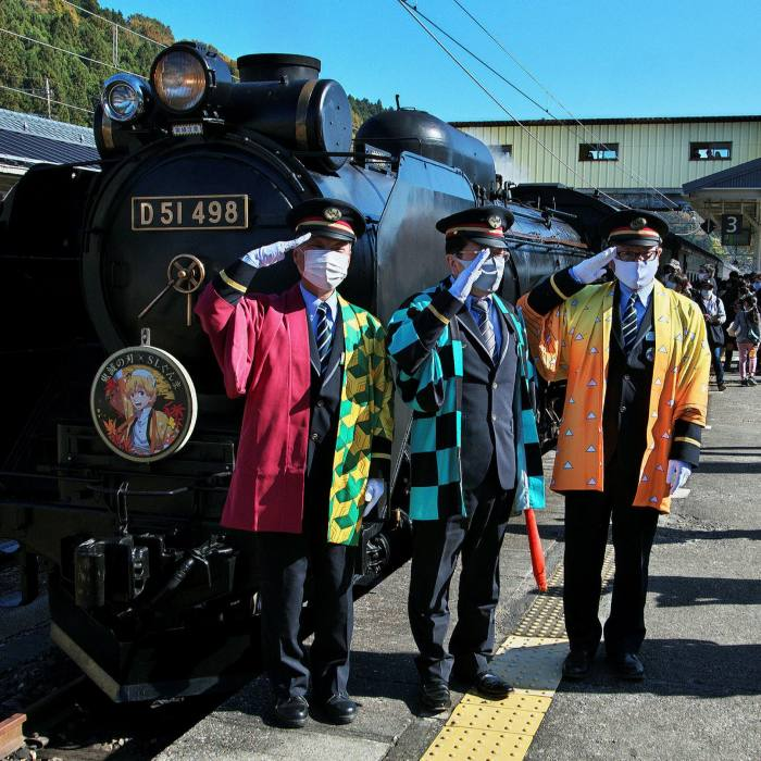 Station attendants at a collaborate event for 'Demon Slayer: Kimetsu no Yaiba' at Yokokawa station in Gunma-Prefecture, Japan, in November