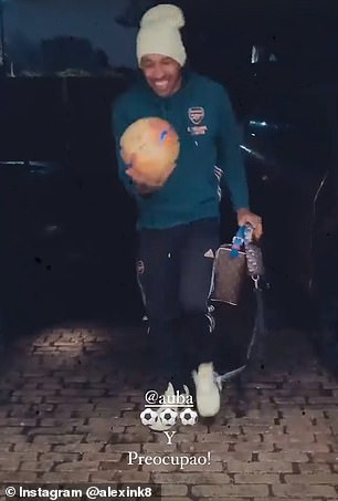 Pierre-Emerick Aubameyang dances with his match ball as he arrived home on Sunday night