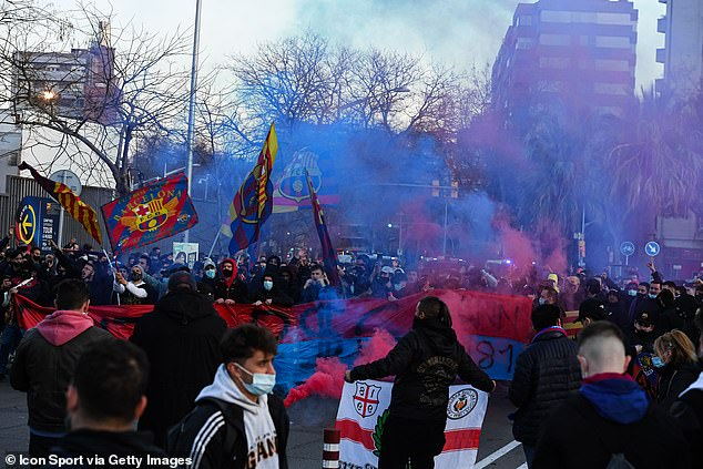 A large number of Barca fans have flouted Covid guidelines to gather outside the Nou Camp