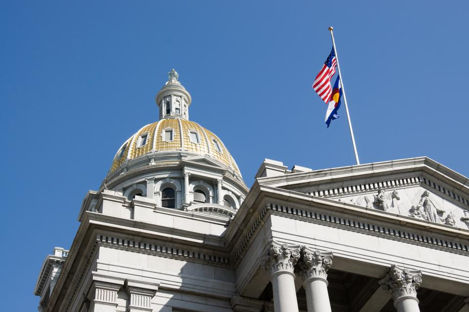 Colorado capitol building and US flag and CO flag