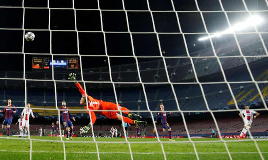 Paris St Germain's Kylian Mbappe curls the ball past Barcelona's keeper Marc-Andre Ter Stegen for his hat-trick.