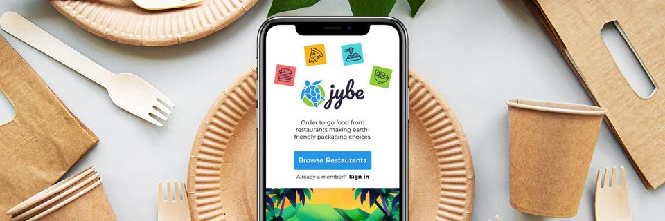 Takeout containers and smart phone with JYBE app on screen.
