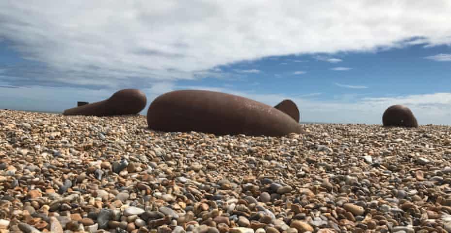 Quartet (Sleeping) by Antony Gormley on Aldeburgh beach