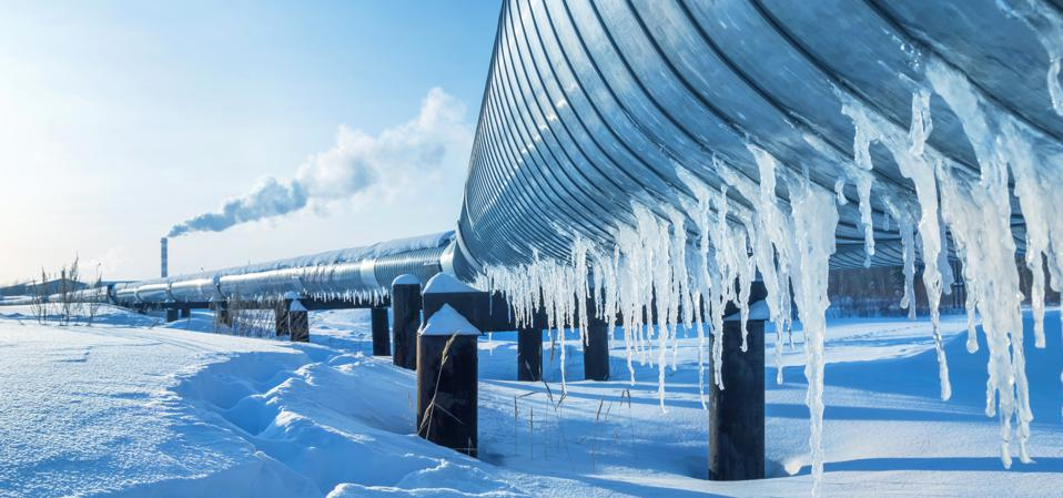 Winter landscape with icicles on the gas pipeline