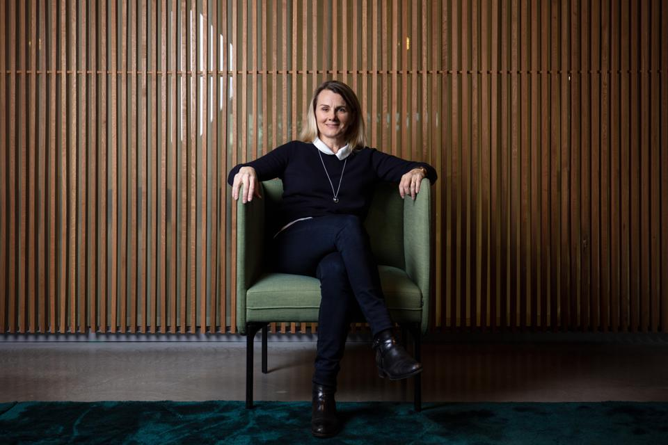Dr Lotta Jakobsson smiles while sitting in a chair