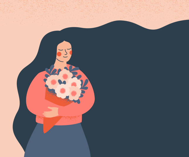 Dreamy woman holding a bouquet of flowers.