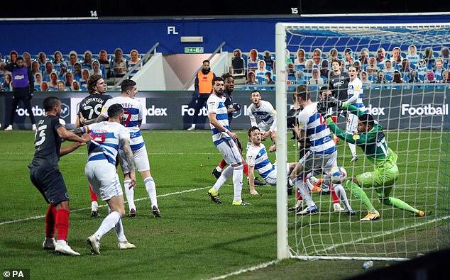The striker met Mathias Jensen's cross to guide the ball beyond Seny Dieng in the QPR goal