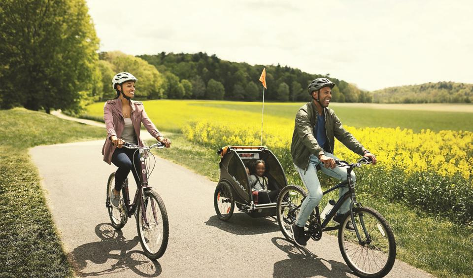 Family riding bikes at the Biltmore Estate.