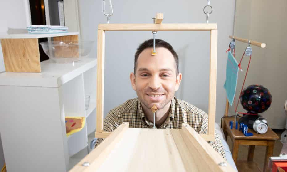 Chain reaction machine artist Joseph Herscher with his inventions at home in Brooklyn, New York