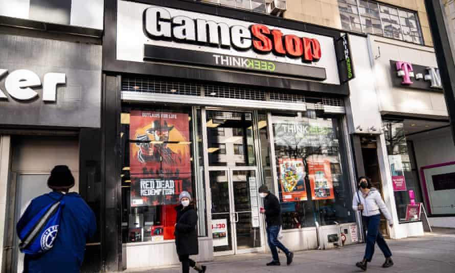 Pedestrians pass a GameStop store in Manhattan