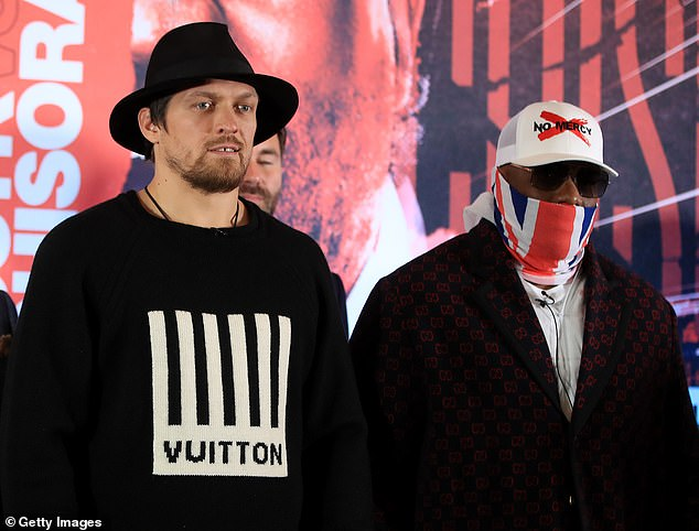 Oleksandr Usyk and Derek Chisora are pictured together on March 13 to promote their fight