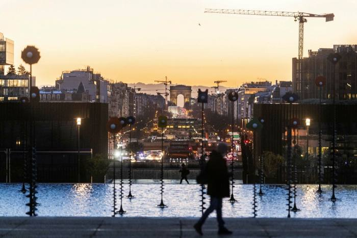 The Arc de Triomphe and the Champs-Elysées as seen from the La Défensebusiness district in Paris: could some office buildings be converted into homes?