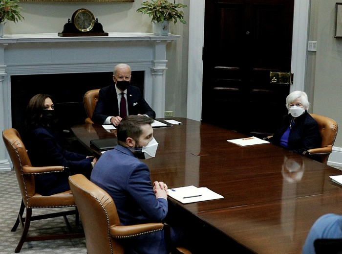 Joe Biden sits at the head of the table with Janet Yellen to his left. The US Treasury secretary said: 'I think that the passage of the American Rescue Plan will finally allow us to do what most of us came to government for . . .  to build a better country'