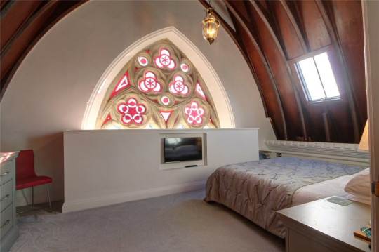 one of the chapel's bedrooms, complete with stained glass windows