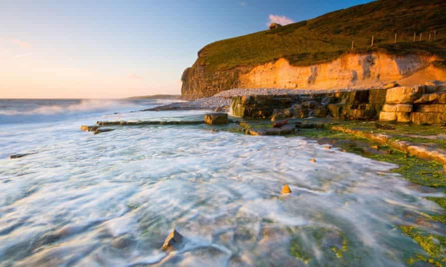 Monknash beach in Glamorgan, Wales, UK cliffs, rocks, tide in