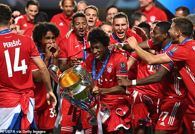 Coman with the Champions League trophy after Bayern Munich beat PSG in the final in Lisbon