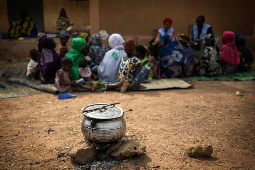 Workers from MINUSMA, the UN mission to Mali, talk to civilians who fled Minima Maoude, a village that was a village that was entirely burned down and at least 18 people killed.