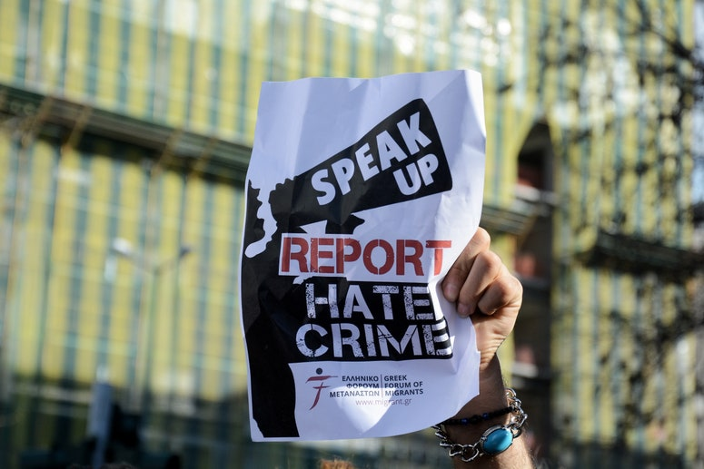 """Flyer that says """"SPEAK UP REPORT HATE CRIME"""""""