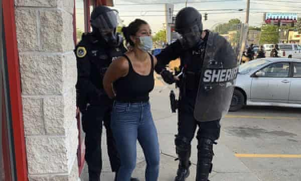 Police officers are shown arresting Des Moines Register reporter Andrea Sahouri after a Black Lives Matter protest she was covering on 31 May 2020 in Des Moines, Iowa, was dispersed by tear gas.