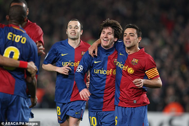 Xavi (right) has heaped praise on Lionel Messi (centre) as he prepares to level his record of 767 Barcelona appearances - they are pictured together playing for the club in 2009