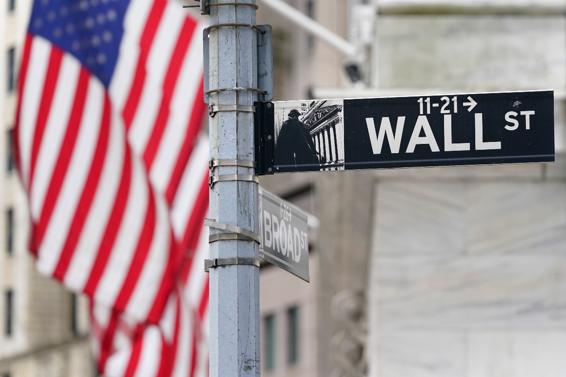 A street sign is displayed at the New York Stock Exchange.
