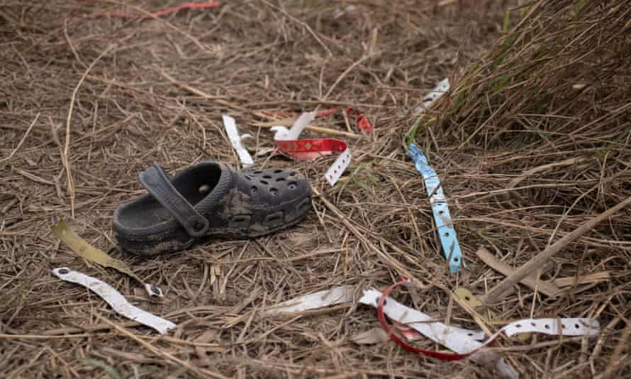 A shoe and wristbands discarded by migrants from along the banks of the Rio Grande.