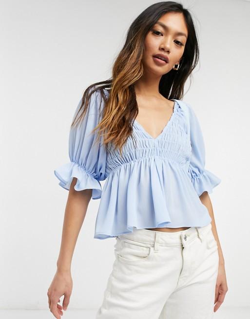 Blue v neck shirred waist shirt
