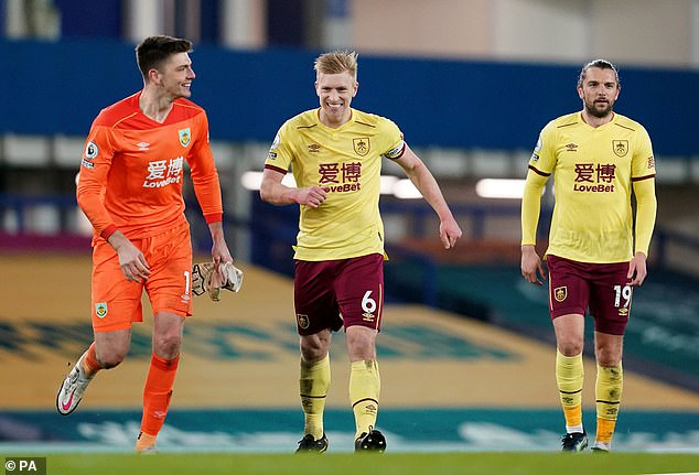 Ben Mee (centre) put in a strong display in Burnley's defence to help his side beat Everton