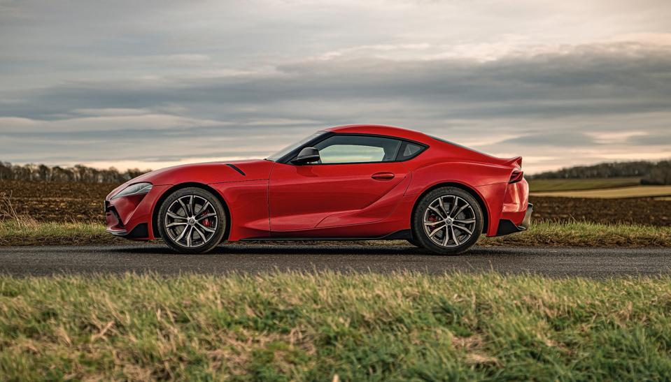 Side view of a red 2021 Toyota GR Supra 2.0