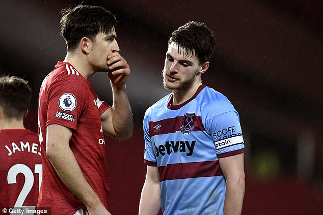 Maguire speaks to Rice after United's 1-0 win over West Ham in the Premier League last month