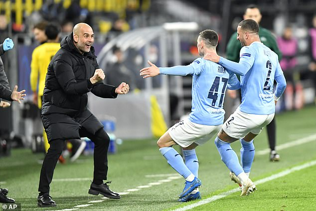 Guardiola celebrates as Manchester City secured their passage to the Champions League semi-finals after a 4-2 win on aggregate over Borussia Dortmund