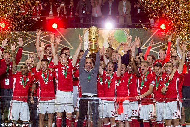 Guardiola lifts the trophy after Bayern beat Dortmund 4-3 on penalties after a goalless draw