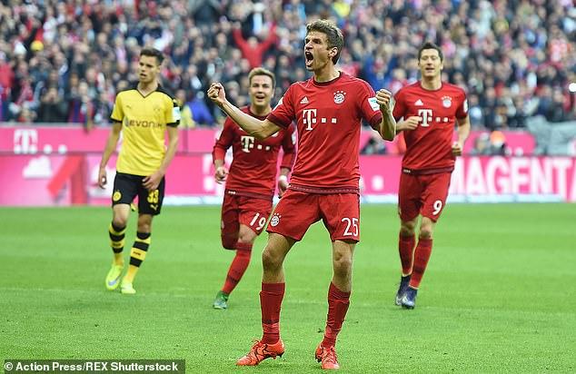 Thomas Muller celebrates scoring for Bayern in their 5-1 win over Dortmund in October 2015