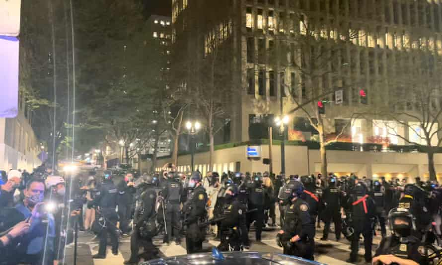 Riot police stand guard during protests in Portland, Oregon, on 16 April.