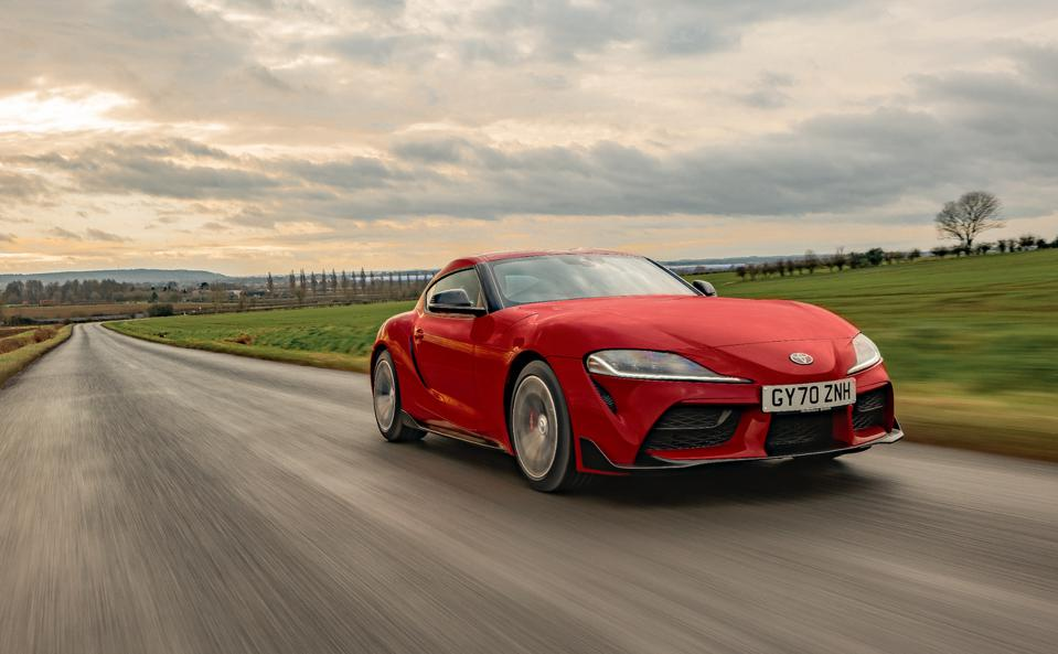 Front three-quarter view of a red 2021 Toyota GR Supra 2.0